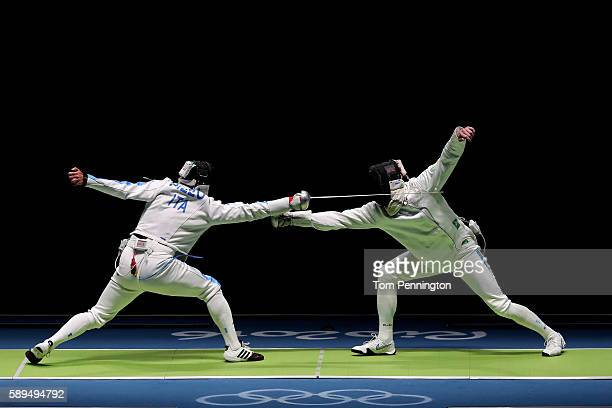 Paolo Pizzo of Italy competes against Bogdan Nikishin of Ukraine during the Men's during the Men's Epee Team Semifinal on Day 9 of the Rio 2016...