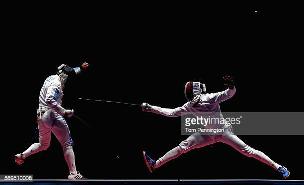 Paolo Pizzo of Italy competes against Daniel Jerent of France during the Men's Epee Team Gold Medal Match on Day 9 of the Rio 2016 Olympic Games at...