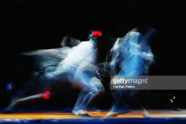 Paolo Pizzo of Italy competes against Ka Ming Leung of Hong Kong in the Men's Individual Epee round of 32 match on Day 5 of the London 2012 Olympic...