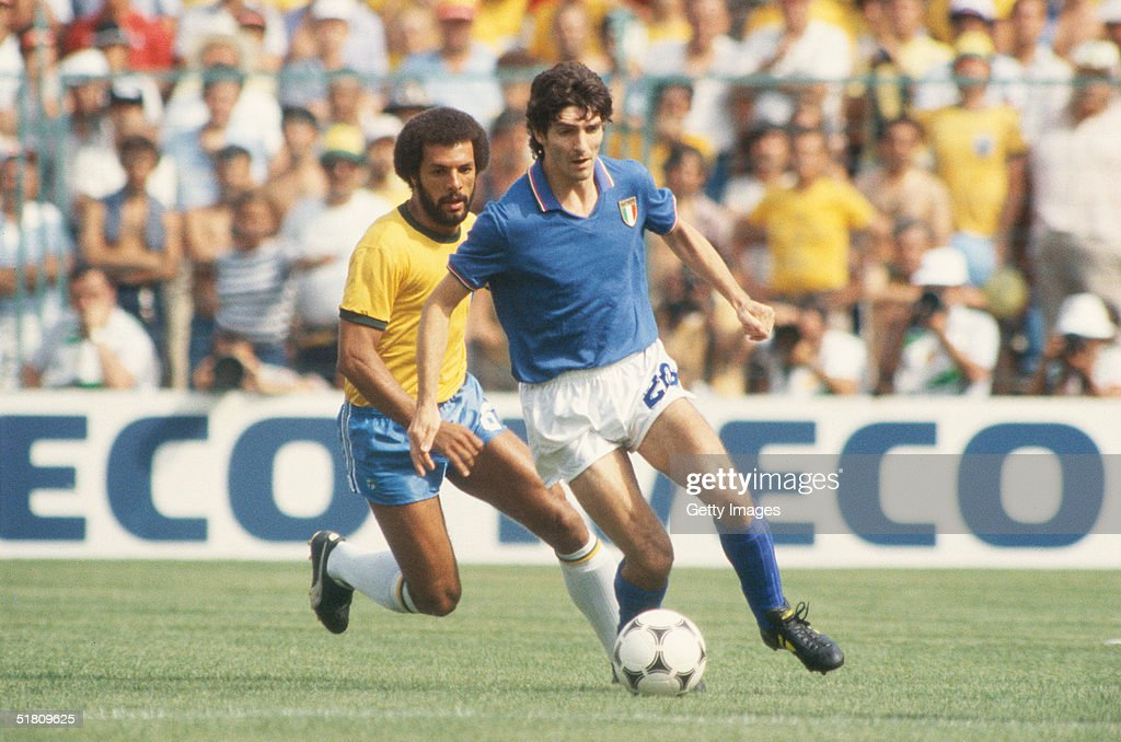 Paolo Rossi of Italy shields the ball from Junior of Brazil during the World Cup Round Two, Group Three match between Brazil and Italy held at the Sarria Stadium, Barcelona, Spain on July 5, 1982. Italy won the match 3-2.