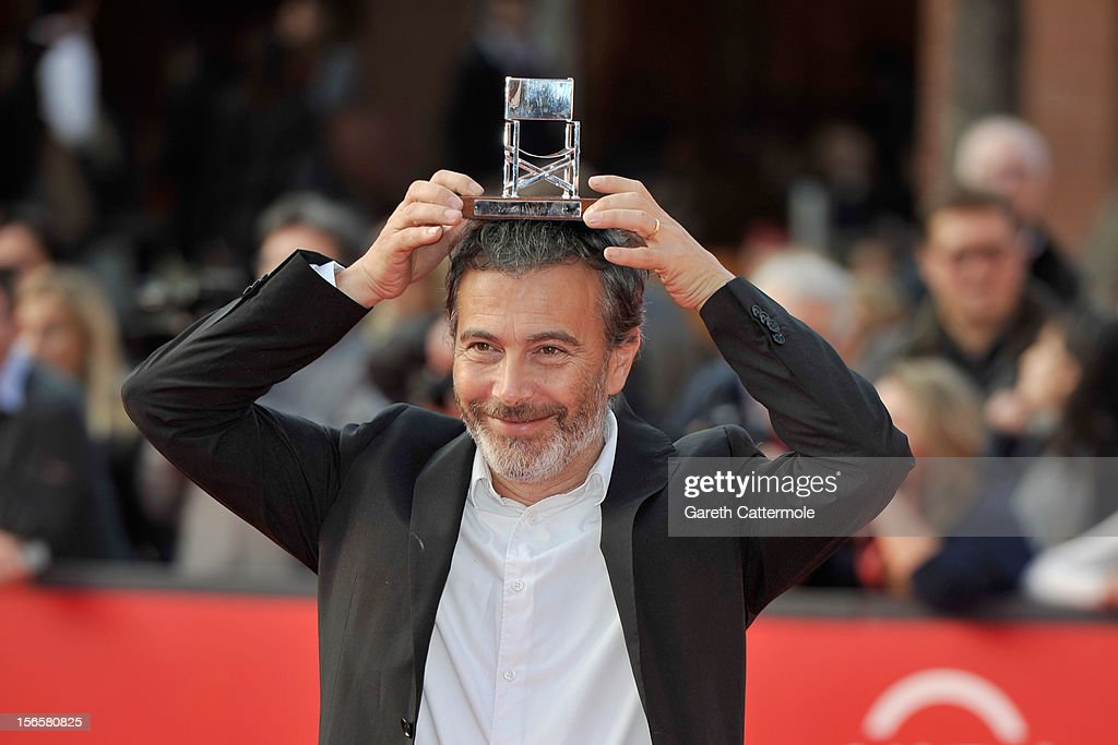 Paolo Sassanelli poses with the L.A.R.A. Award for Best Italian Actor as he attends the Collateral Awards Red Carpet photocall during the 7th Rome Film Festival at Auditorium Parco Della Musica on November 17, 2012 in Rome, Italy.