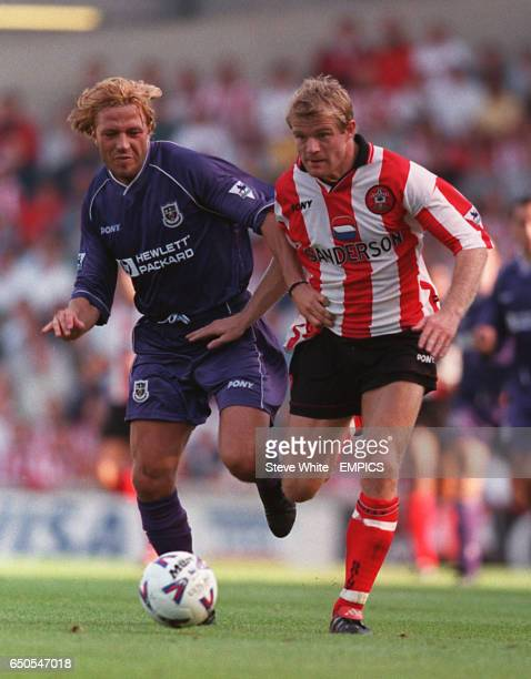 Paolo Tramezzani of Tottenham Hotspur in a race for the ball with Egil Ostenstad of Southampton