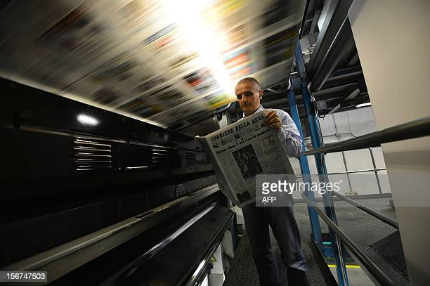 Paolo Trisi in charge of supervising the printing of the 'Corriere della Sera' newspaper checks the edition of the November 8 with its frontpage on...
