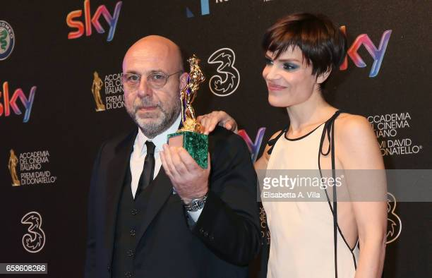 Paolo Virzi and Micaela Ramazzotti pose with the Best Movie Award for 'La Pazza Gioia' at the end of the 61 David Di Donatello ceremony on March 27...