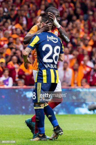 Papa Alioune N'Diaye of Galatasaray SK Mathieu Valbuena of Fenerbahce SK during the Turkish Spor Toto Super Lig football match between Galatasaray SK...
