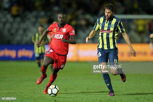 Papa Babacar Diawara of Adelaide controls the ball ahead of Antony Golec of the Mariners during the round seven ALeague match between the Central...