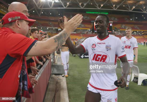 Papa Babacar Diawara of Adelaide United celebrates with fans after the win during the round two ALeague match between the Brisbane Roar and Adelaide...