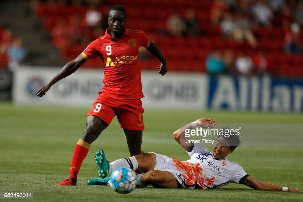 Papa Babacar Diawara of Adelaide United is tackled by Kim Woni of Jeju United during the AFC Asian Champions League match between Adelaide United and...