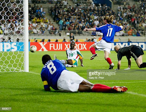 Papa Bouba Diop of Senegal scores the winning goal against France as goalkeeper Fabien Barthez Emmanuel Petit and a grounded Marcel Desailly of...