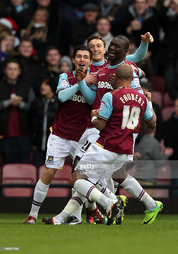 Papa Bouba Diop of West Ham United celebrates his goal with team mates during the npower Championship match between West Ham United and Barnsley at the Boleyn Ground on December 17, 2011 in London, England.