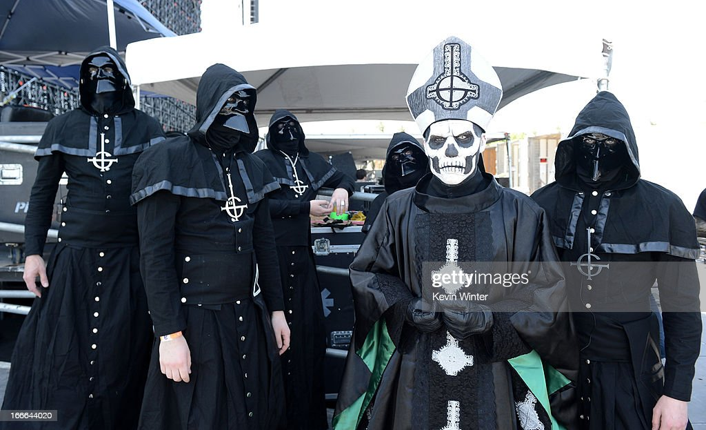 Papa Emeritus II and the Nameless Ghouls of the band Ghost BC pose backstage during day 3 of the 2013 Coachella Valley Music Arts Festival at the...