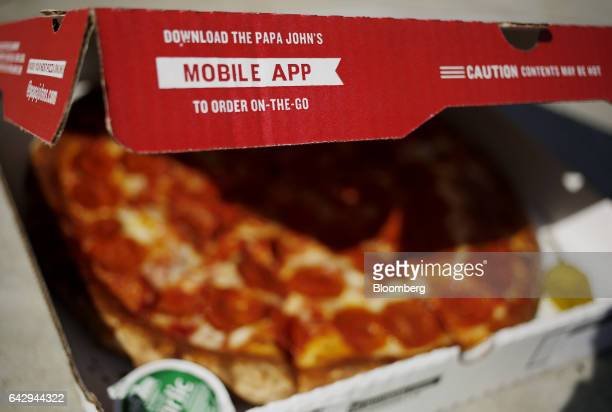 A Papa John's International Inc pizza box sits arranged for a photograph in Shelbyville Kentucky US on Friday Feb 10 2017 Papa John's is scheduled to...