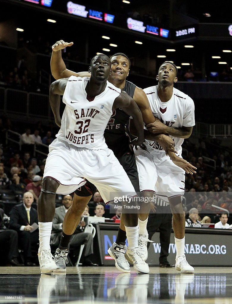 Papa Ndao #32 and Daryus Quarles #11 of the Saint Joseph's Hawks box out Terrance Shannon #2 of the Florida State Seminoles during the championship game of the Coaches Vs. Cancer Classic at the Barclays Center on November 17, 2012 in the Brooklyn borough of New York City.