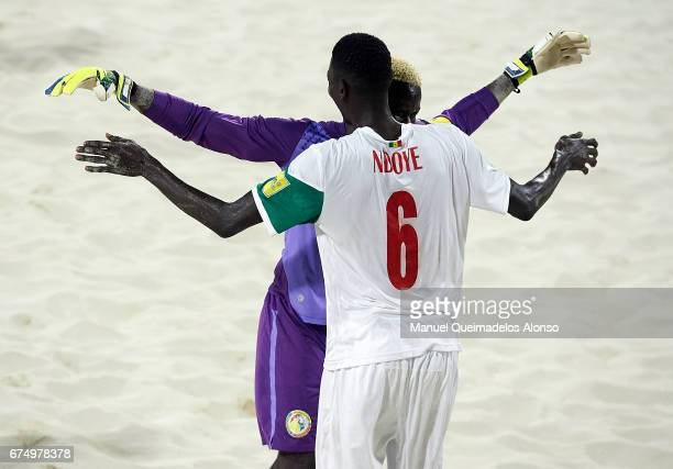 Papa Ndoye of Senegal celebrates a goal with his teammate Al Seyni Ndiaye during the FIFA Beach Soccer World Cup Bahamas 2017 group A match between...