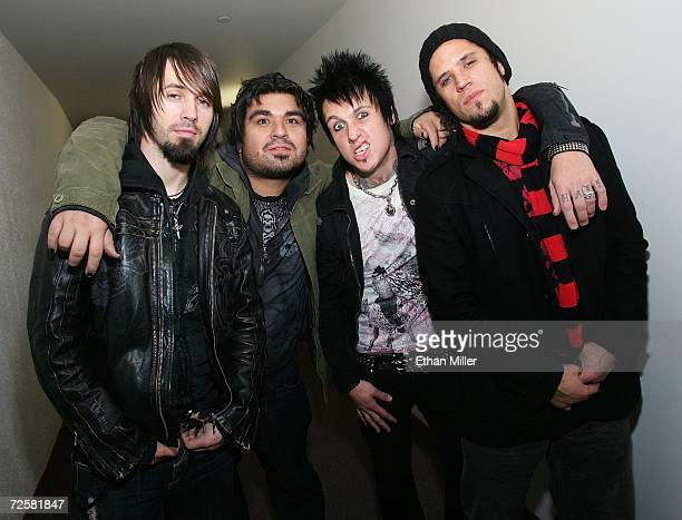 Papa Roach guitarist Jerry Horton drummer Dave Buckner singer Jacoby Shaddix and bassist Tobin Esperance pose backstage at Xtreme Rock Radio's...