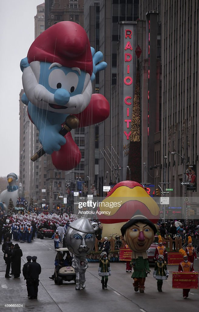 A Papa Smurf balloon floats for the 88th Annual Thanksgiving Day Parade outside Macy's Department Store in Herald Square on November 27, 2014 in New York City.