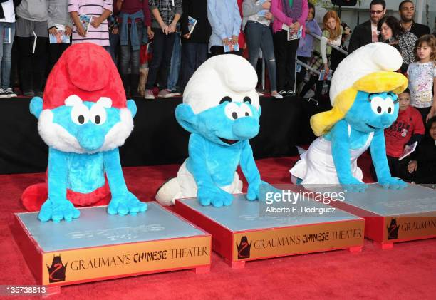 Papa Smurf Clumsy Smurf and Smurfette attend a hand and footprint ceremony Immortalizing The Smurfs at Grauman's Chinese Theatre on December 13 2011...