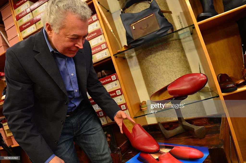 Papal shoemaker Adriano Stefanelli poses with a pair of shoes, the same model of these worn by Pope Benedict XVI, on March 1, 2013 in his shop in Novara. Stefanelli, who made shoes for Popes John Paul II and Pope Benedict XVI, is also expected to have the next Pope as a customer.