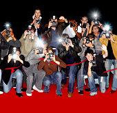 Paparazzi behind cordon at premiere using flash cameras