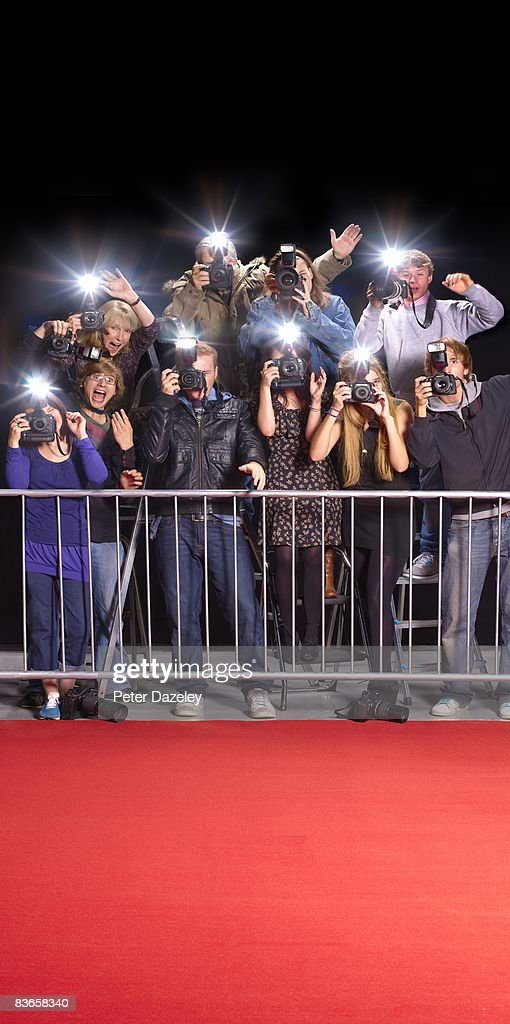Paparazzi behind railings and red carpet : Stock Photo