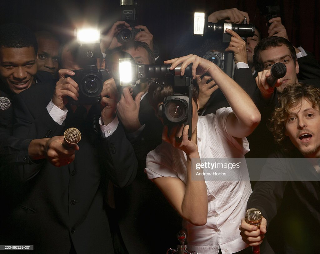 Paparazzi photographers and television reporters at celebrity event : Stock Photo