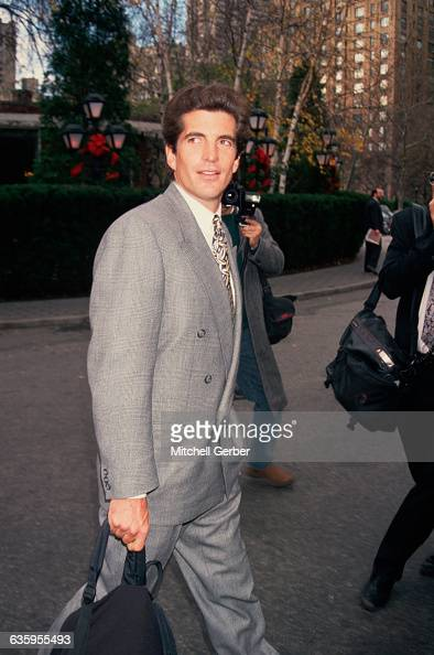 Paparazzi photographers take pictures of John F Kennedy Jr on a New York City street