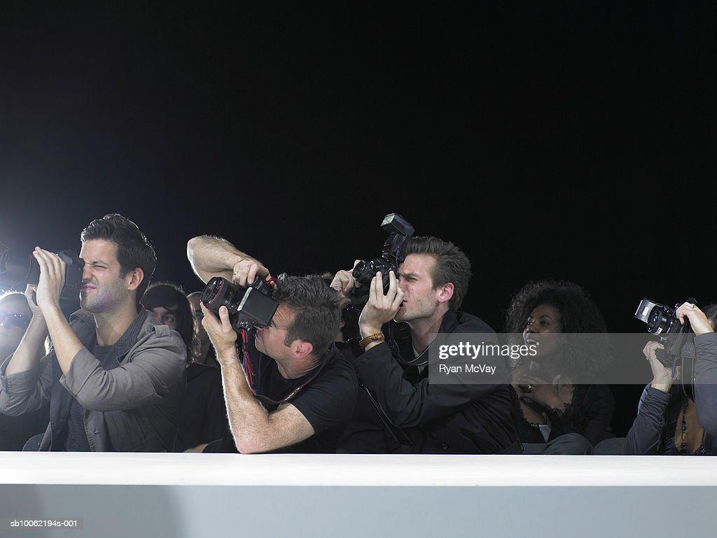 Paparazzi photographing fashion show : Stock Photo