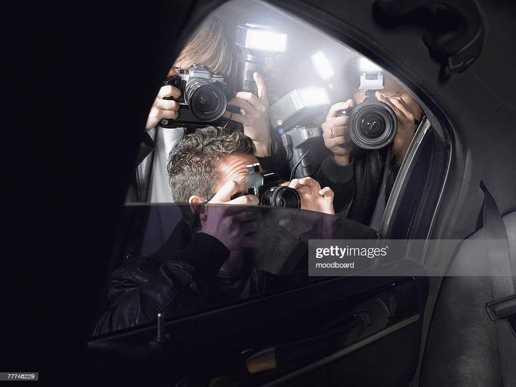 Paparazzi Shooting Inside a Limousine : Stock Photo