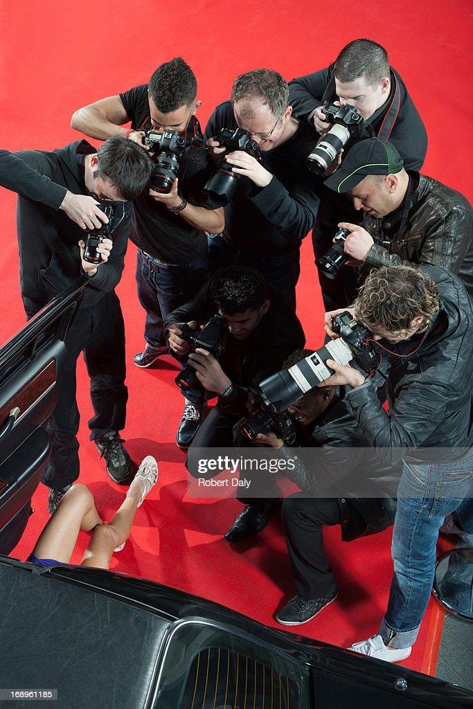 Paparazzi taking photos of celebrity's car : Stock Photo