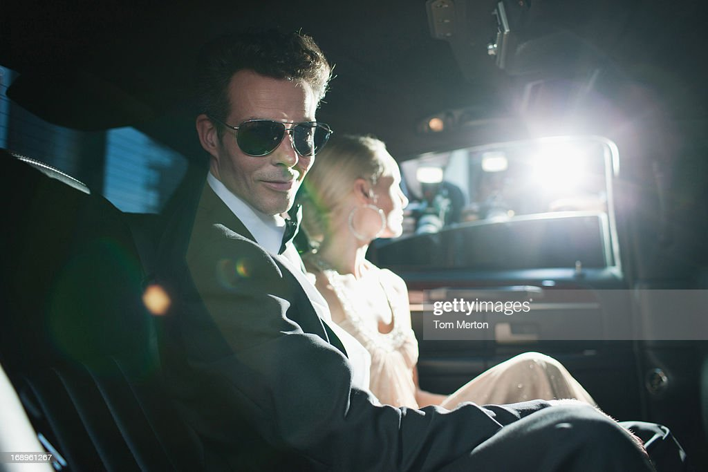 Paparazzi taking pictures of celebrities in limo