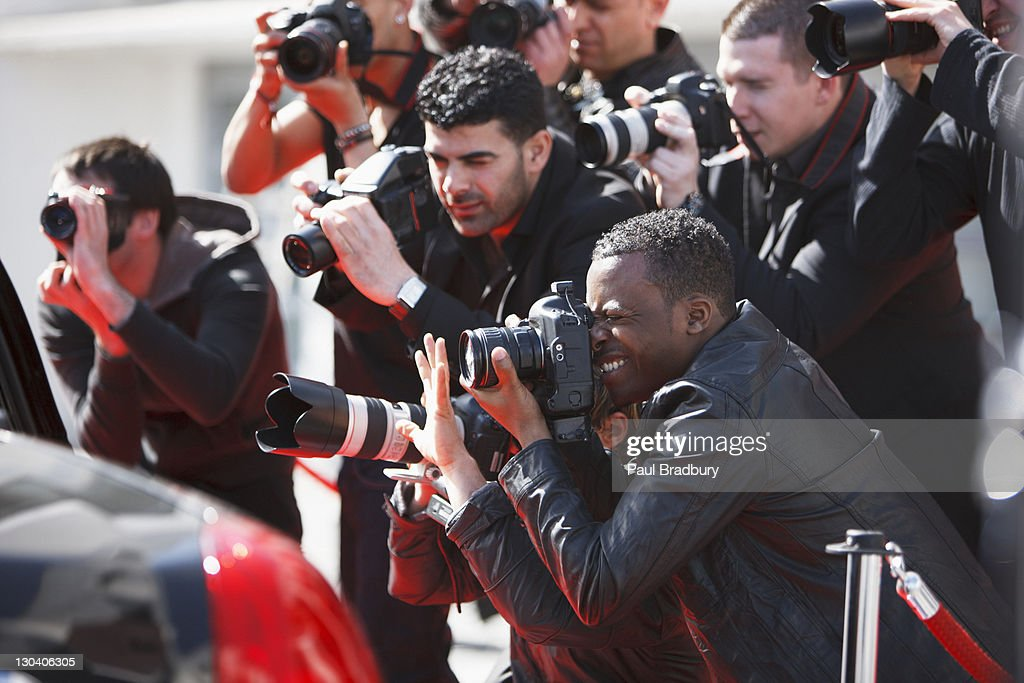 Paparazzi taking pictures : Stock Photo