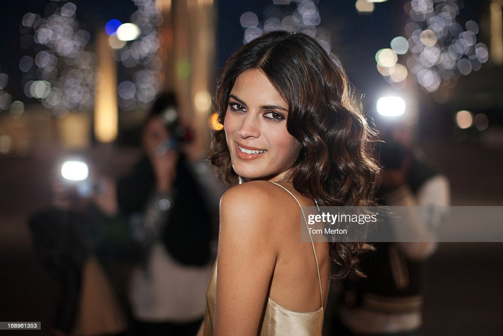 Paparazzi taking smiling celebrity's picture : Stock Photo