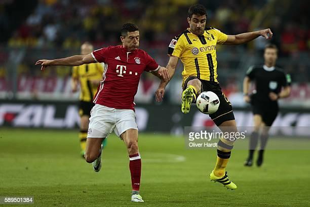 Papastathopoulos Sokratis of Dortmund and Robert Lewandowski of Munich compete for the ball during DFL Supercup 2016 match between Borussia Dortmund...