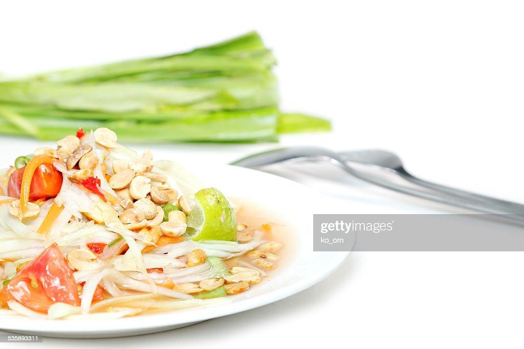 Salade de papaye accompagnée de cuisine thaïlandaise : Photo