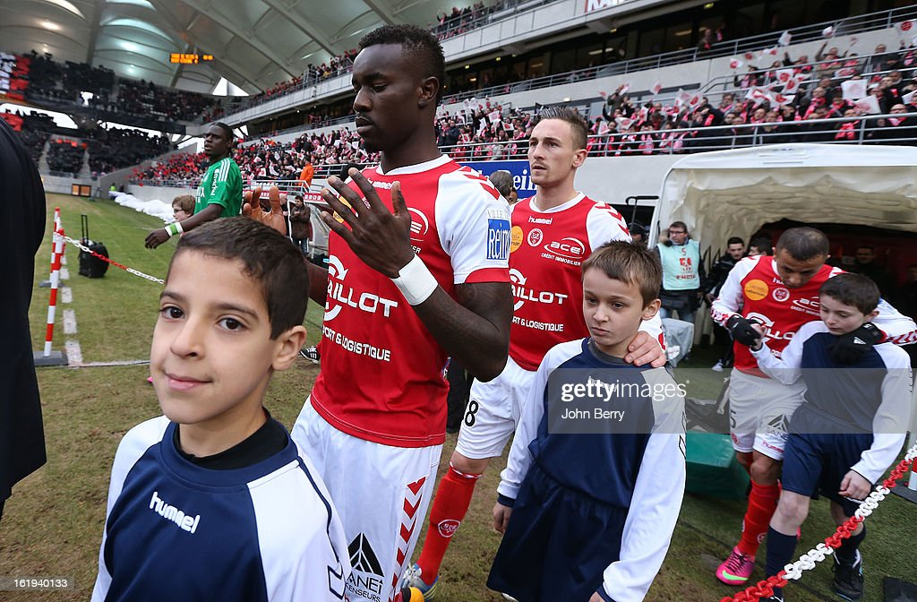 Pape Ndiaye Souare and Gaetan Courtet of Reims enter the field prior to the french Ligue 1 match between Stade de Reims and AS Saint-Etienne at the Stade Auguste Delaune on February 17, 2013 in Reims, France.
