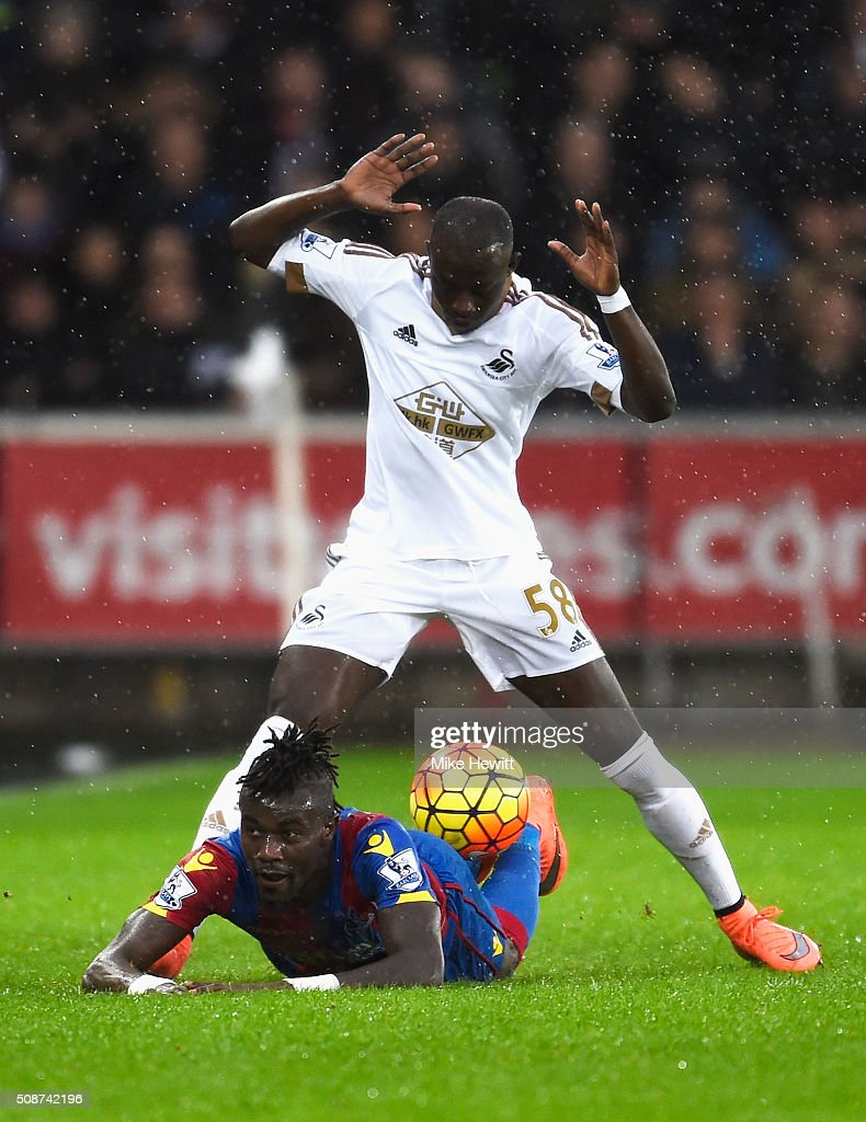 Pape N'Diaye Souare of Crystal Palace and Modou Barrow of Swansea City compete for the ball during the Barclays Premier League match between Swansea City and Crystal Palace at the Liberty Stadium on February 6, 2016 in Swansea, Wales.