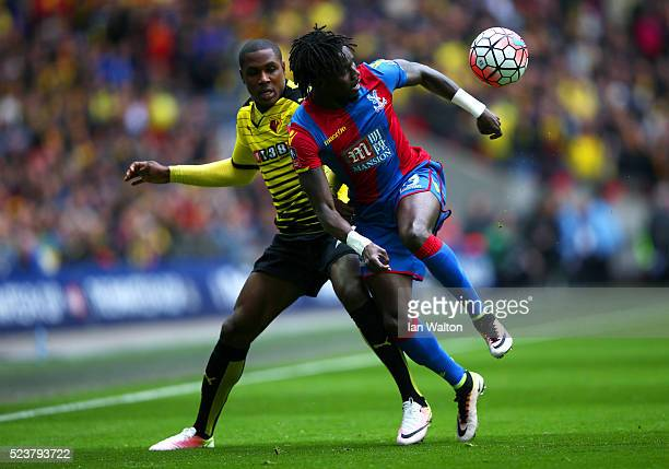 Pape N'Diaye Souare of Crystal Palace battles with Odion Ighalo of Watford during The Emirates FA Cup semi final match between Watford and Crystal...