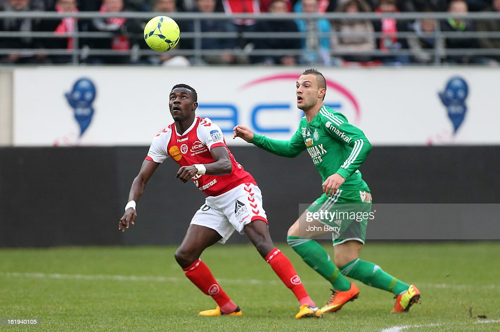 Pape Ndiaye Souare of Reims and Yohan Mollo of ASSE in action during the french Ligue 1 match between Stade de Reims and AS Saint-Etienne at the Stade Auguste Delaune on February 17, 2013 in Reims, France.