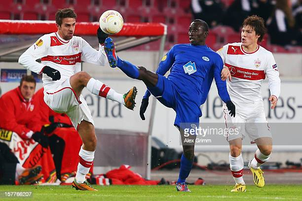 Pape Pate Diouf of Molde is challenged by Martin Harnik and Gotoku Sakai of Stuttgart during the UEFA Europa League group E match between VfB...