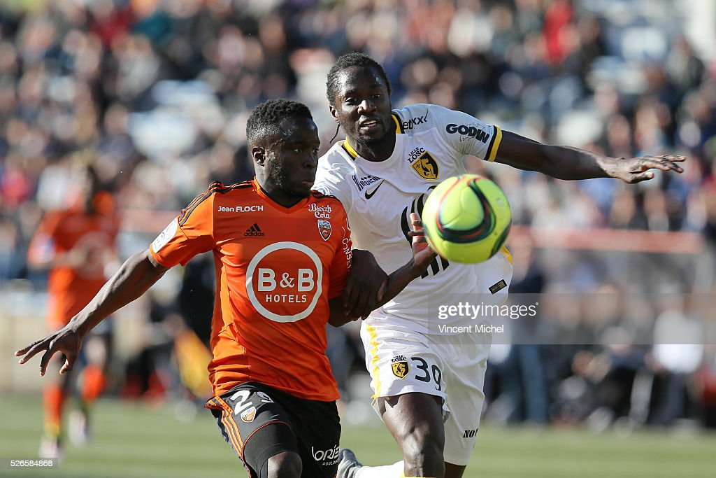 Pape Paye of Lorient and Eder of Lille during the French Ligue 1 match between Fc Lorient and Lille OSC at Stade du Moustoir on April 30, 2016 in Lorient, France.