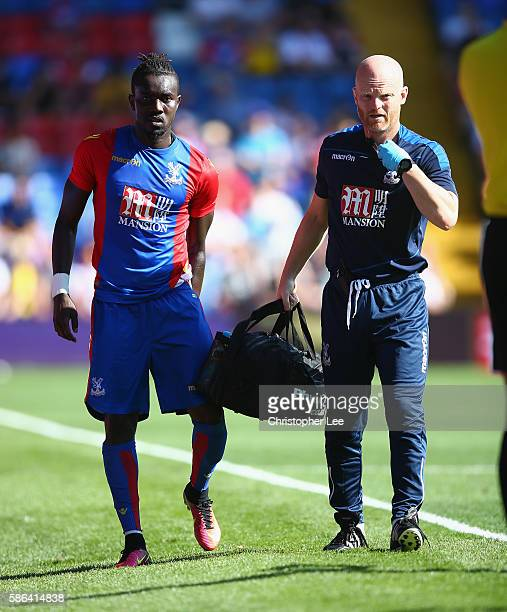 Pape Souare o fCrystal Palace leaves the field holding his thigh during the Pre Season Friendly match between Crystal Palace and Valencia at Selhurst...