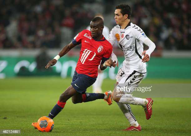 Pape Souare of Lille and Aissa Mandi of Reims in action during the french Ligue 1 match between LOSC Lille and Stade de Reims at the Grand Stade...