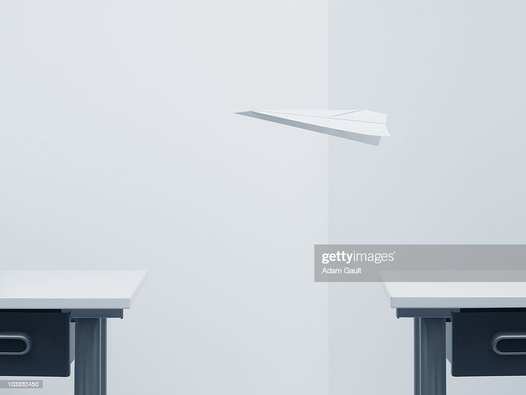 Paper airplane flying across room