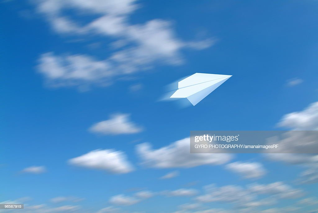 Paper Airplane Flying in Sky : Stock Photo