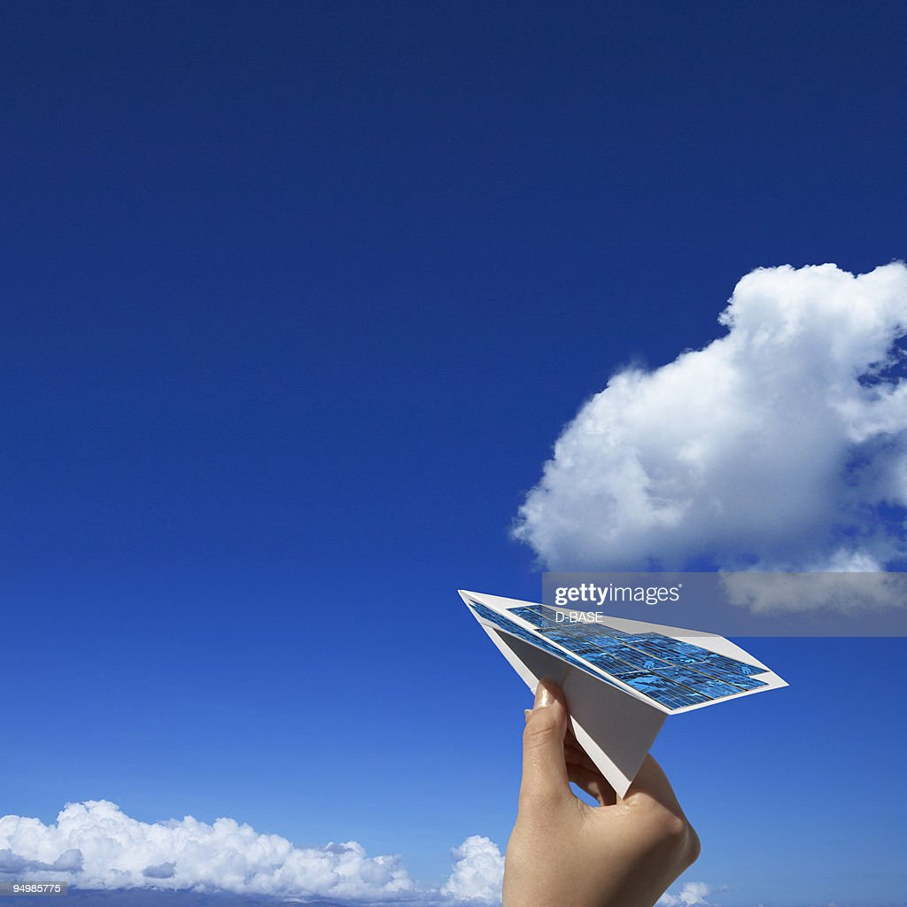 paper airplane with solar panels. : Stock Photo