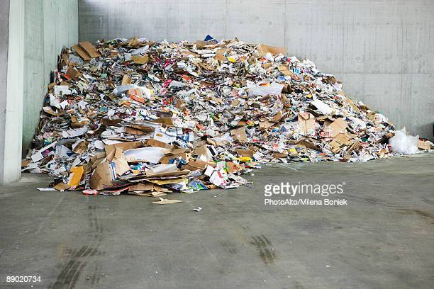 Paper and cardboard piled up in recycling center