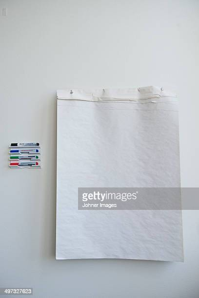 Paper and markers on wall
