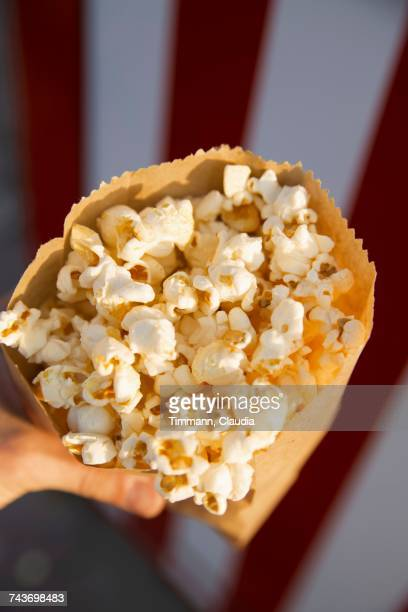 A paper bag full of popcorn