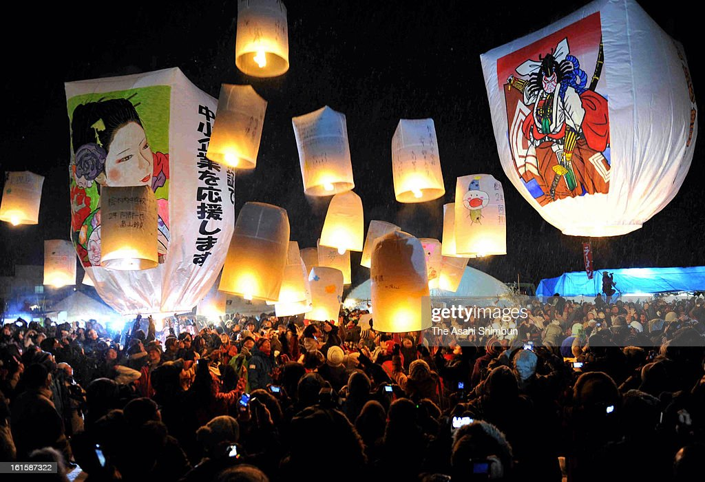 Paper balloons light up the night sky on February 11, 2013 in Senboku, Akita, Japan. The night skies of Senboku were ablaze in a warm orange light as the people in this northern Japanese city celebrated their traditional Kami Fusen Age (Flying Paper Balloon) festival.