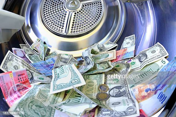 Paper bills on several currency inside a washing machine